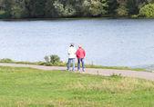 Two mature women walking near river — Stock Photo