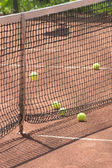 Court, tennis balls and net closeup — Stock Photo