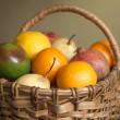 Fruits collected in brown wicker basket — Stock Photo