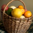 Fruits collected in brown wicker basket — Stock Photo #21204371