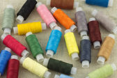 Color spools with thread close up — Stock Photo