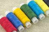 Colored spools with threads close up — Stock Photo