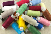 Colored spools with thread close up — Stock Photo