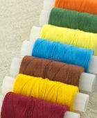 Colored spools with threads close up — Stok fotoğraf