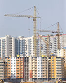 Tower cranes construction city buildings — Stock Photo