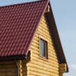 Stock Photo: Top of country wooden house in retro style