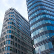 High modern office buildings in a city over blue sky close up — Stock Photo