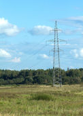 Country landscape with power line metal pilon — Stock Photo