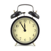Alarm clock in black case and beige clockface isolated close up — Stock Photo