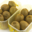 Ripe kiwi fruits in plastic container isolated closeup — Stock Photo