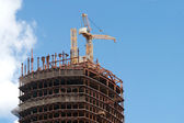 Crane in building construction activity process — Stock Photo