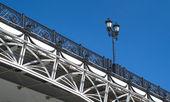 Retro styled arc bridge with decorative fence — Stock Photo