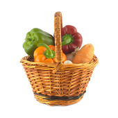 Vegetables in brown wicker basket isolated — Stock Photo