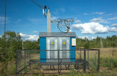 Transformer of rural power supply line in countryside — Stock Photo