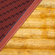 Wooden house wall and part of red roof from metal tile closeup — Stock Photo #38305485