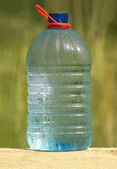 Plastic bottle with ecologically pure drinking water — Stock Photo