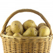 Stock Photo: Potatoes in brown wicker basket isolated closeup