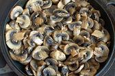 Many fried mushrooms in a pan closeup — Stock Photo