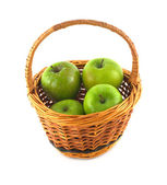 Ripe green apples in brown wicker basket isolated closeup — Stock Photo