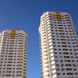 Two new constructed buildings over clear blue sky — Stock Photo
