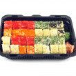 Sushi rolls with fish roe Masago lies in plastic container isolated — Stock Photo