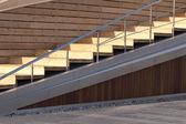 Wooden staircase with metal railing, horizontal photo — Stock Photo