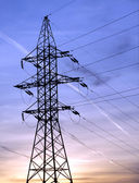 Power supply line metal tower on beautiful sunset vertical view — Stock Photo