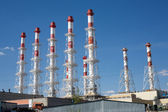 Power station buildings with many high smoke pipes — Stock Photo