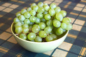 Grape on branch in green bowl closeup — Foto Stock