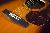 Acoustic guitar top with six strings closeup — Stock Photo