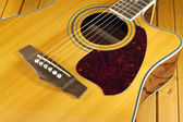 Acoustic guitar top with six strings closeup — Стоковое фото
