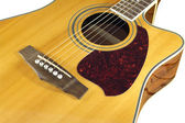 Acoustic guitar top with six strings isolated closeup — Stock Photo