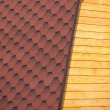 Wooden house wall and part of red roof from soft tile closeup — Stock Photo #45160647