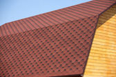 Wooden house wall and brown roof tile closeup — Stock Photo