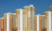 New buildings over blue clear cloudless sky — Stock Photo
