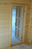 Opened door inside new built wooden house. Vertical view — Foto Stock