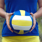 Girl holding a colorful sports ball for volleyball. Closeup Photo — Stock Photo