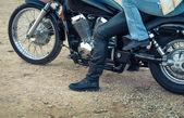 Couple on motorbike — Stock Photo