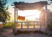 Tropical beach on sunset — Stock Photo