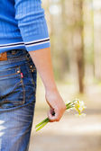 Flowers in a hand — Stock Photo