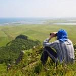 Man looking in binoculars, the border of Russia with North Korea — Stock Photo