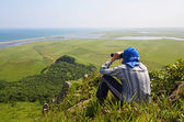 Man looking in binoculars, the border of Russia with North Korea — Stock Photo