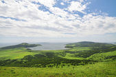 Green hills and blue sky, Primorye, Russia — Stock Photo