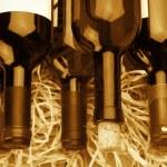 Wine bottles in straw — Stock Photo