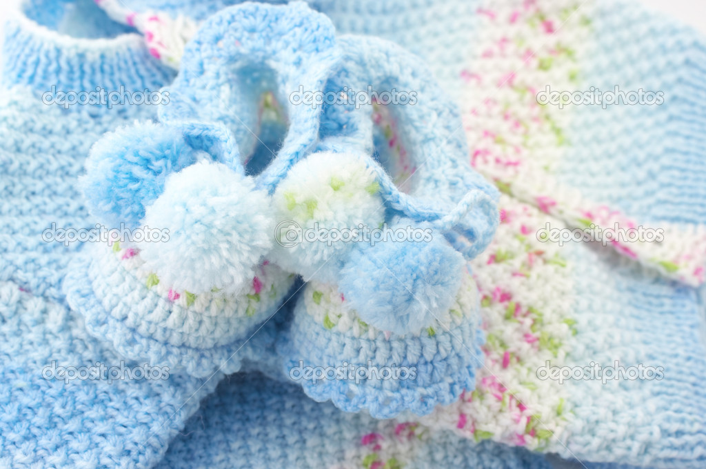 Handmade baby's knitted clothes close-up.  Stock Photo #12804748
