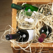 Picnic basket with wine - Stock Photo