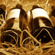 Wine bottles in straw — Stockfoto