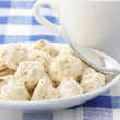 Almond cookies and cup — Stock Photo