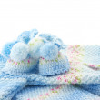 Foto Stock: Baby's knitted clothes