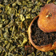 Pu-erh tea aged in tangerine and green tea - Stock Photo